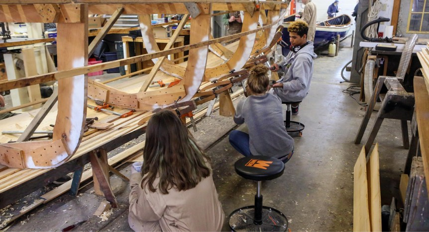 Students building a new boat