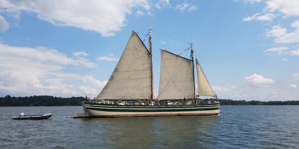 A canal schooner sailing on the lake