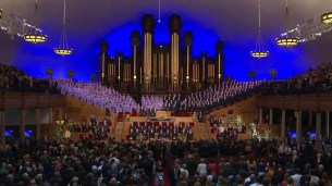 The crowd rises as President Packer's casket is brought inside the Tabernacle.
