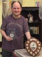 David Leathar standing with the sheild