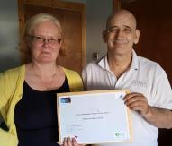 Tommy receiving his certificate