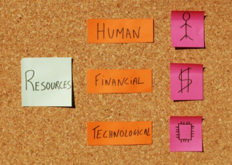concept of tree important resources (human, financial, technological) on a corkboard with colorful notes
