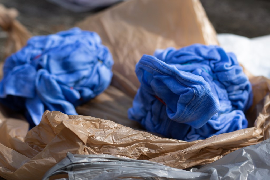 two shirts after being dyed with blue fabric dye