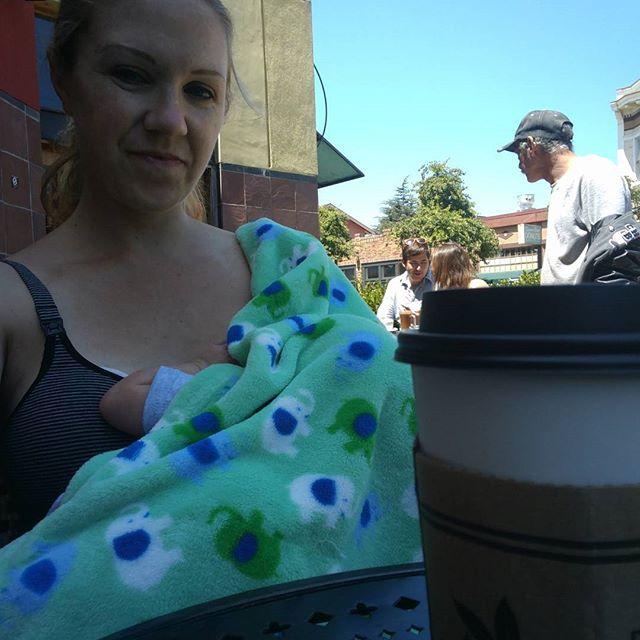 "Mid-walk refreshment break.  Almond milk latte for mom, breast milk ""latte"" for @edisoncurran. 🍼"