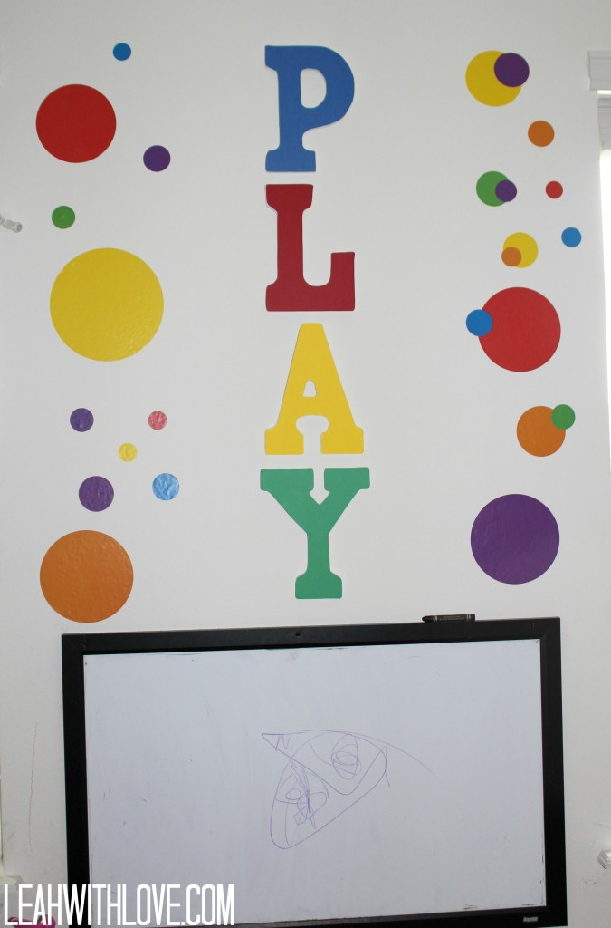Superb The play art along with the colorful wall stickers were the first thing I did to the playroom when we moved in It was three days before L was born and