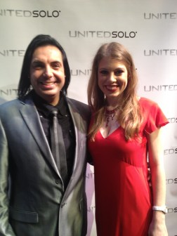 Leandra Ramm picture, wearing red dress with a performer with grey suit middle close up Take Two