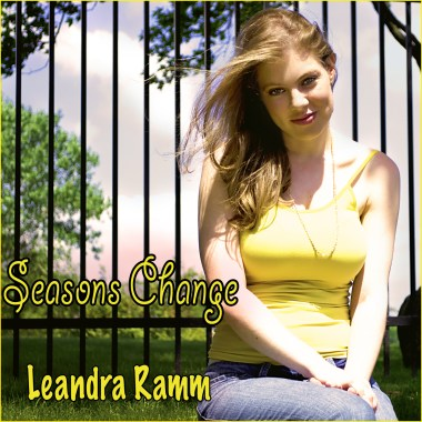 Leandra Ramm picture, wearing yellow singlet sitting down for Season Change Album Cover