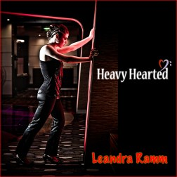 Leandra Ramm picture, wearing black dress and pants leaning towards a wall for Heavy Hearted Album Cover