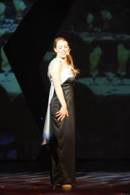 Leandra Ramm picture, singing and wearing white and black dress Take Three