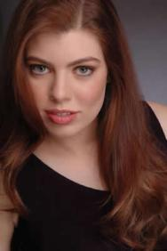 Leandra Ramm picture, wearing dark brown dress middle close up Take Four