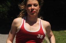 Leandra Ramm picture, wearing red shirt running middle close up Take One