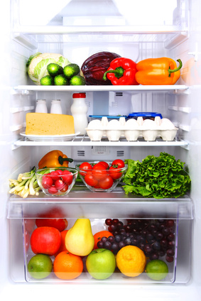 a refrigerator filled with dairy products and vegtables