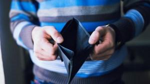 20160602153905-businessman-empty-wallet-no-money-profit-cash-financial-crisis