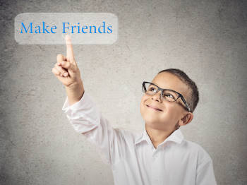 Boy clicks on Make Friends Button, isolated grey wall background