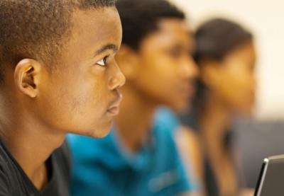 male student listening