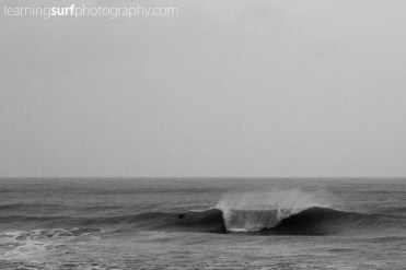 My friend Ross Duerden took this one using my camera, I had been experimenting with focus settings so he switched to sports mode for this and took one of my favourite photo's of the recent swells.