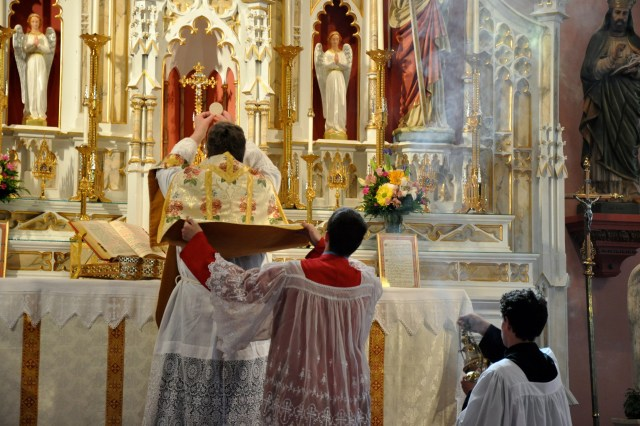 Elevation of the Host during Mass at St. Mary's Oratory, Rockford, IL (Photo © Scott P. Richert)