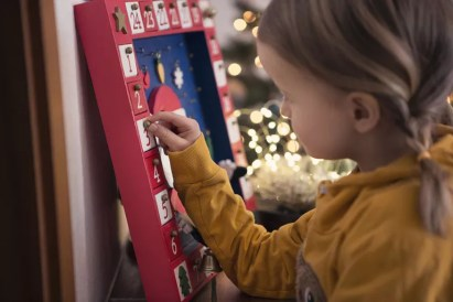 Girl (4-5) Opening Christmas Advent Calendar