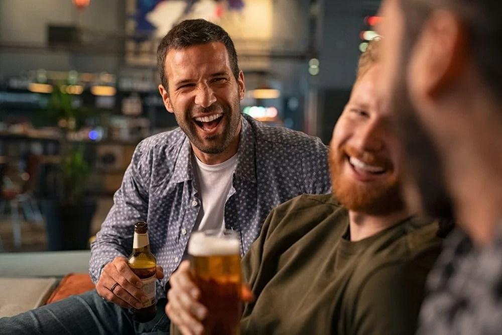Friends enjoying beer at pub