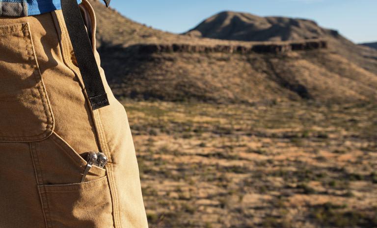 Leatherman skeletool multi-tool clipped in pocket, used outdoors