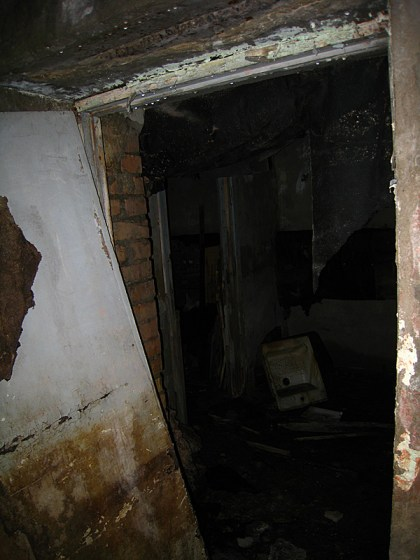 The basement. We were curious to enter but scared out of our wits. So we tried using our camera flashes as flashlights.