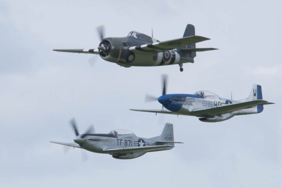 North American P-51D Mustang F-AZXS, TF-51 D-FTSI & Grumman FM-2 Wildcat G-RUMW 01 Flying Legends 2015
