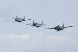 North American P-51D Mustang F-AZXS, TF-51 D-FTSI & Grumman FM-2 Wildcat G-RUMW 02 Flying Legends 2015