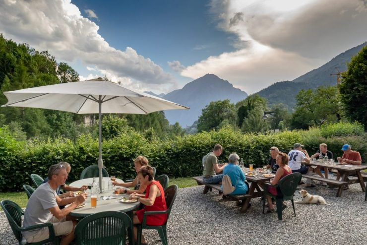 guests eating dinner with mountains in the background
