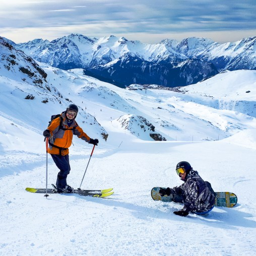 rent skis in oz skier and snowboarder on piste