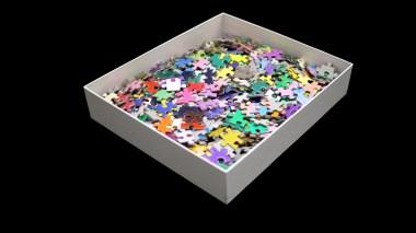 Une boîte de puzzle avec des pièces multicolores
