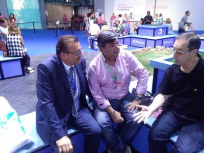 Il Presidente di Confartigianato Giuseppe Michelini e il Direttore Ivan Simeone incontrano Padre Alfredo Abbondi di Comunione e Liberazione nei padiglioni del Meeting