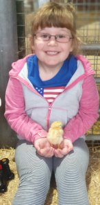 Heidi holding a chick