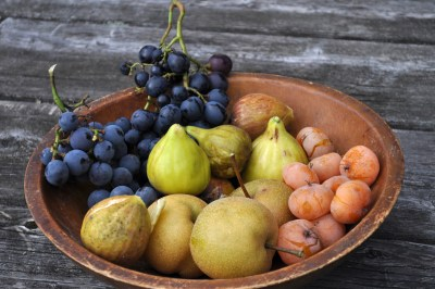 Fruit bowl with fig, grape, persimmon, nashi