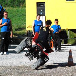 Kid on quad bike