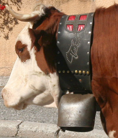 <Detailed French cow bell with the Croix de Savoie flag>