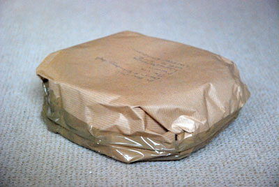 Brown paper-wrapped package in Haute Savoie, France, copyright Wendy Hollands