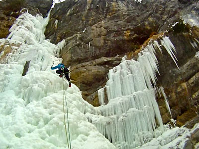 <Picture of a cliff covered in icicles being climbed>