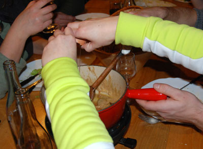 <Photo of an egg cracked into fondue, at a refuge on Beauregard, La Clusaz>