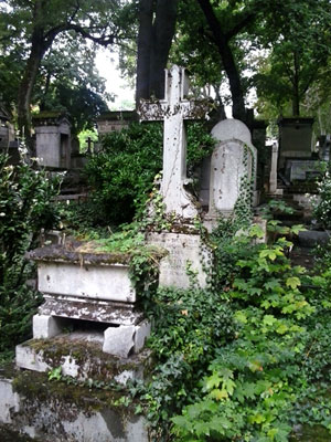 <Photo of plants overtaking graves at Pere Lachaise cemetery in Paris, France. >