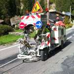 Road painter in French Alps