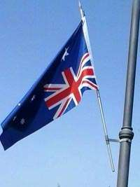 <Photo of an Australian flag hanging upside down in Europe'>