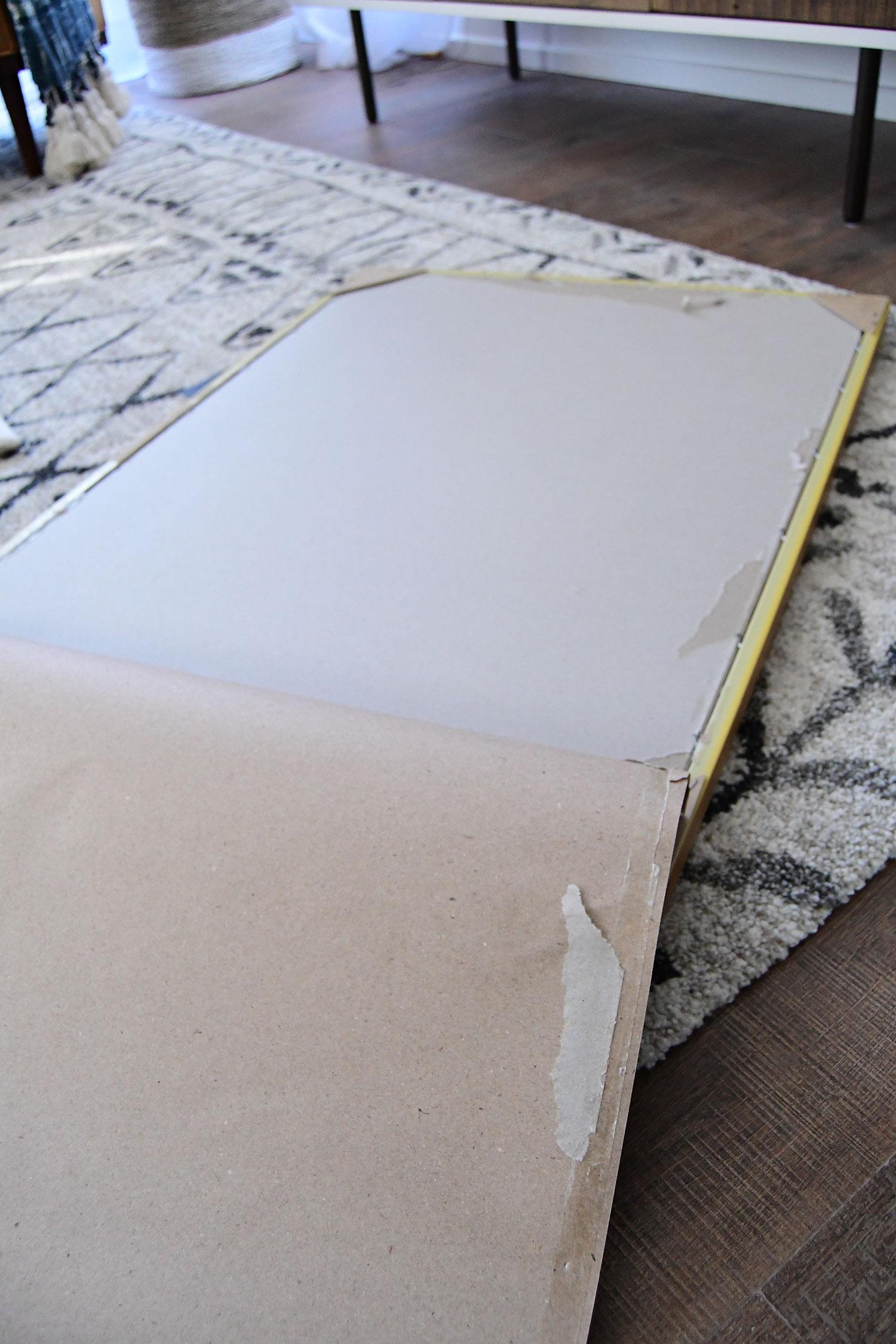 087435ef0ec9 How to frame big art on a small budget no building involved jpg 1500x2250  Target diy