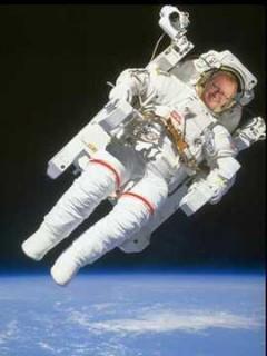 Luke Akehurst in spacesuit orbiting planet Earth