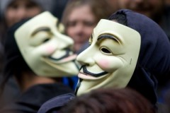 Occupy protesters in face masks