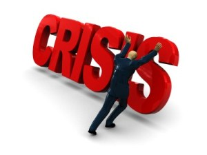 """a man pushing over the word """"crisis"""""""
