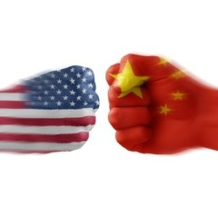US and Chine flags superimposed on fists