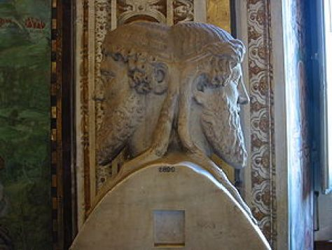The sculpture depicts the Roman God Janus whose two heads saw both forward into the future and into the past. T It's something we are supposed to due (but typically don't) in January of each year. This god was typically found at the entrance of a Roman home with one face looking outside and the other inside.