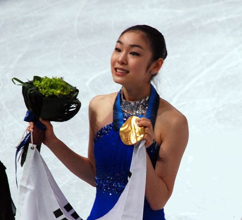 Yun-Na Kim Showing her Gold medal for figure skating. Image by: amex