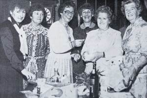 The Lady Mayoress, Mrs Eirlys Lewis tries her luck at Mrs Dilys Bailey's tombola stall at a sherry evening held at the Manor House.