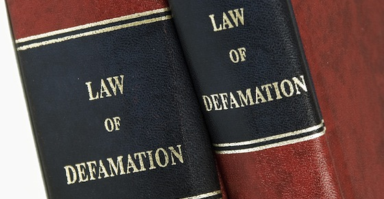 What are the conditions to be satisfied under criminal law in defamation case?